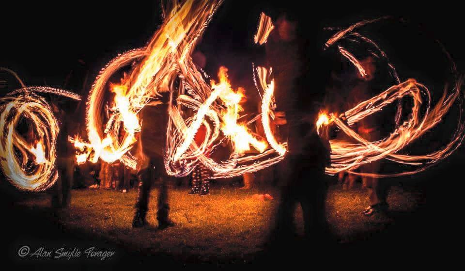 people spinning fire