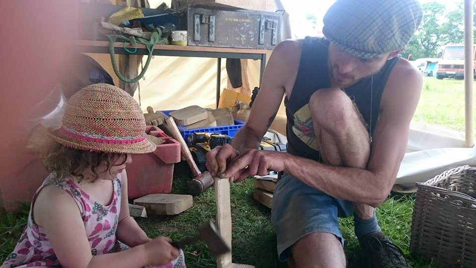 Man and child doing woodwork together