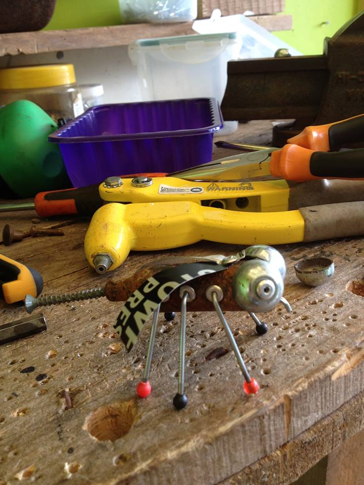 tools and metal bug sculpture