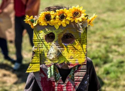 Child wearing hand-made mask